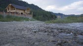 ciel : A mountain river flows along the forest and a lovely wooden house