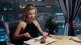 Girl is Having Dinner in the Restaurant Wideo