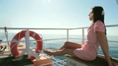 weather : woman resting on the deck