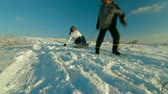 tobogganing : Pulling Sledge Through Winter Landscape Stock Footage