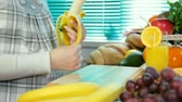 meal : Pregnant woman sliced banana in the kitchen Stock Footage