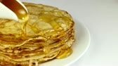 terça feira : stack of pancakes with syrup over white Vídeos