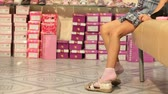 girl : Choosing Shoes in Shoe Store Stock Footage