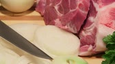 preparations : Sliced fresh pork meat and vegetables on wooden cutting board close-up dolly shot