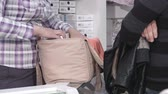 pack : Young family buying pregnancy hospital bag for pregnant women in baby and maternity shop
