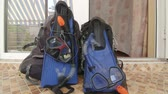 door : Two backpacks with snorkeling gear at entrance to hotel room at beach resort Stock Footage
