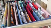drying rack : Balcony extended clothes drying rack with hanging colorful laundry Stock Footage