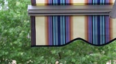 тент : Detail of modern striped awnings in the rain