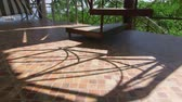 patio : Shadows on terrace ceramic tiled floor in sunny day Stock Footage