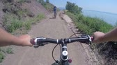 j��zda na kole : First-person POV Mountain biking on trail along wild sea shore of Crimea Dostupné videozáznamy