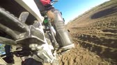 bike ride : Enduro racer riding bike on dirt track rear wheel point of view Stock Footage