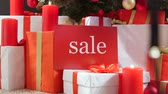 ribbon : Christmas sale sign with wrapped gift boxes Stock Footage