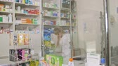 sale : SIMFEROPOL, RUSSIA - CIRCA OCTOBER 2015: Young female pharmacist counter assistant working in pharmacy drugstore