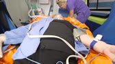 fornecer : Emergency medical service senior person in ambulance during transport to hospital Stock Footage
