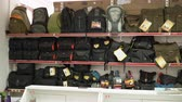 display case : Interior of camera store. Shelves with camera bags, backpacks and cases for sale