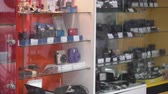 photography shot : Interior of camera store. Display cases with new digital cameras and accessories