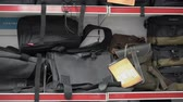 display case : Interior of camera store. Camera bags, backpacks and cases for sale on display Stock Footage