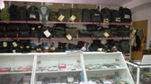 ombro : Interior of camera store. Shelves with photographic equipment and camera bags