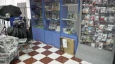 голову выстрел : Interior of camera store with photographic equipment and gear.