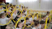 group of children : KALININGRAD, RUSSIA - APRIL 05, 2018: A demonstration sports performance with hoops. A morning performance in kindergarten