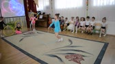 senta : KALININGRAD, RUSSIA - APRIL 05, 2018: A demonstration sports performance with a tape. A morning performance in kindergarten
