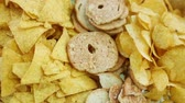snacks : Potato chips on plate. Food background