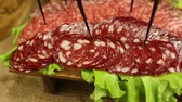 dry sausage : Food background of cured sausage. Sausage Slices
