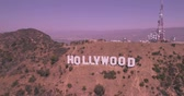 Голливуд : Aerial Drone View of the Hollywood Sign, California at Sunset Стоковые видеозаписи