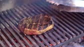 Ribeye steak roasted on the grill barbecue. Slow motion. 120 fps.