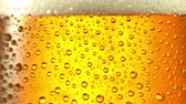Glass of beer. Close up 4K video. Black background.