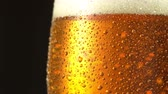 Glass of beer. Close up 4K video. Macro shooting. Stock Footage