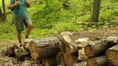 men : Man walking on a wooden bridge in the forest. Hiking. Stock Footage