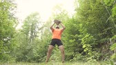 strength : Man In Summer Forest Lifts A Heavy Stone. Slow Motion. Stock Footage
