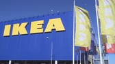 inexpensive : SAMARA, RUSSIA - AUGUST 29, 2016: IKEA flags against sky at the IKEA Samara Store. IKEA is the worlds largest furniture retailer.