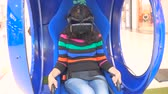 play video game : SAMARA, RUSSIA - SEPTEMBER 05, 2016 Young woman on virtual reality glasses play virtual environment. Virtual reality game. Girl with pleasure uses head-mounted display. Stock Footage