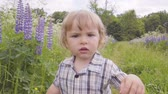 descontente : Angry little boy hands bangs the camera in the park looking at camera. Slow motion