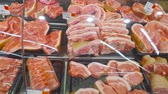 dana eti : Selling a piece of meat in the store. Selection of different cuts from fresh meat raw red in a supermarket.