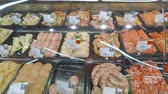 refrigerated : Selling a piece of meat in the store. Selection of different cuts from fresh meat raw red in a supermarket.