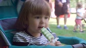lody : Little boy eating ice cream at an outdoor in park