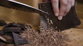 ezilmiş : Chopped dark chocolate on kitchen board. Chopping a Bar of Chocolate While Making Baking. Slow motion. Close up. Chop on wooden board. Closeup. Stok Video