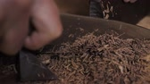すりおろし : Chopped dark chocolate on kitchen board. Chopping a Bar of Chocolate While Making Baking. Slow motion. Close up. Chop on wooden board. Closeup. 動画素材