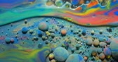 zwaartekracht : Slow Motion Bright Colors Bubbles Oil Beautiful Paint Universe Color Moving Multicolored Closeup. Acrylic Paint. Fantastic Surface. Abstract Colorful Paint Metamorphosis Structure Colorful Bubbles