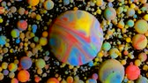 partícula : Slow Motion Bright Colors Bubbles Oil Beautiful Paint Universe Color Moving Multicolored Close Up. Acrylic Paint. Fantastic Hypnotic Surface. Abstract Colorful Paint Metamorphosis Structure Bubbles Stock Footage
