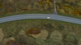 путь : AERIAL View Flying Above Stunning Fall Nature and Road Running Through Picturesque Countryside. Road in Autumn Scenery Aerial Shot. Car Driving Road Leading Through Colorful Landscape on Autumn Day. Стоковые видеозаписи