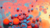 Slow Motion Bright Neon Color Bubbles Oil Beautiful Fluorescent Paint Sparkling Color Moving Multicolor Close up. Acrylic Neon Paint. Fantastic Surface. Abstract Colorful Transformation Gravitation.