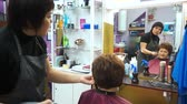 hair cut : Stylist with a client looking in the mirror