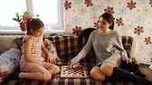 Sisters playing checkers