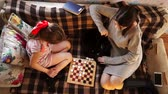 The game of checkers of two sisters