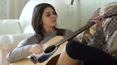 ruivo : Beautiful girl playing guitar Stock Footage
