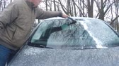 Remove snow and ice from the car window